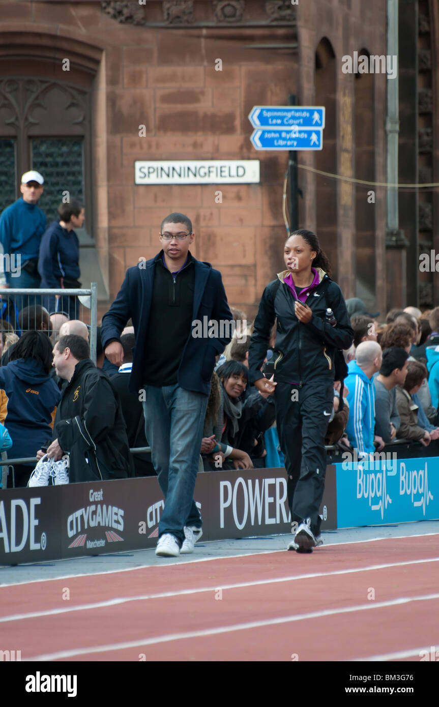Allyson Felix walking down the running track after winning a 200m race at the Great CityGames in Manchester on 16th - Stock Image