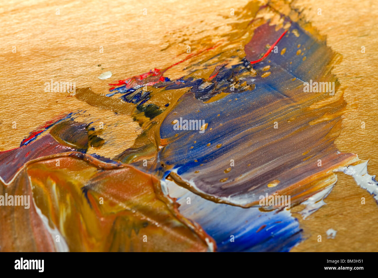 Smeared paint on a wooden palette - Stock Image