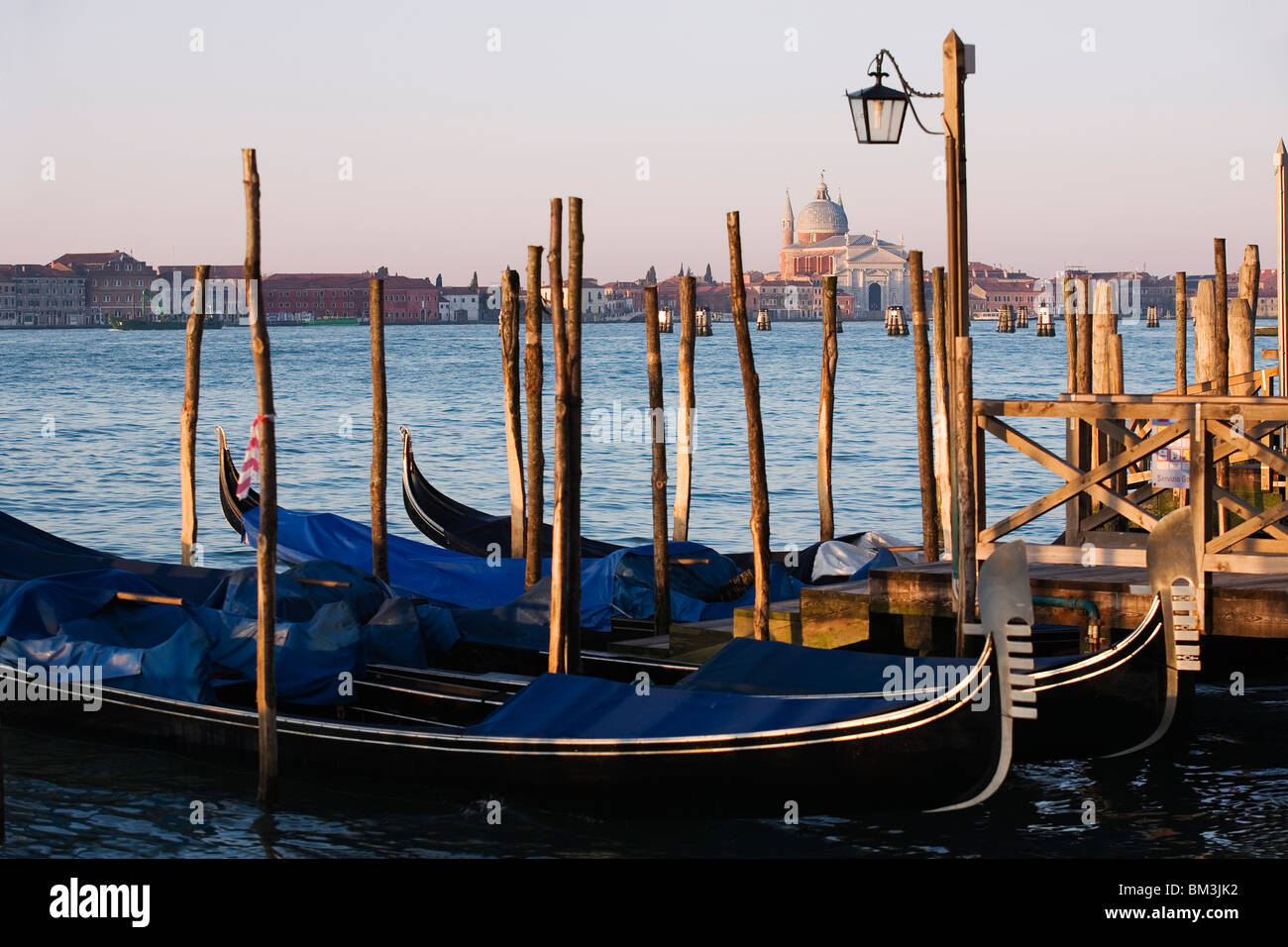 Venice - View across the Grand Canal from San Marco towards Santa Maria della Salute with Gondolas moored in the - Stock Image