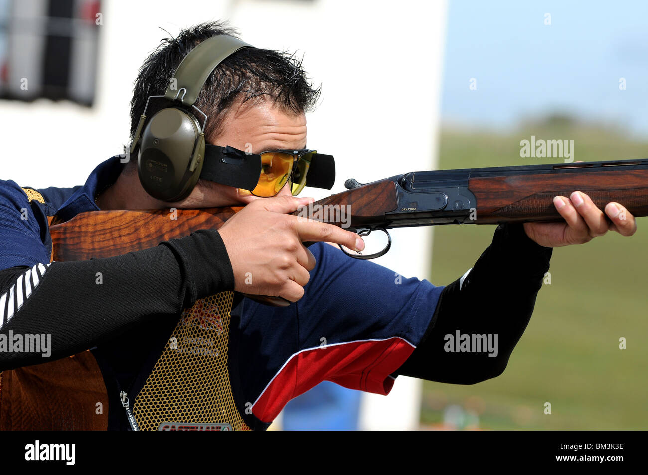 Shotgun competition, competitor at a shotgun contest - Stock Image