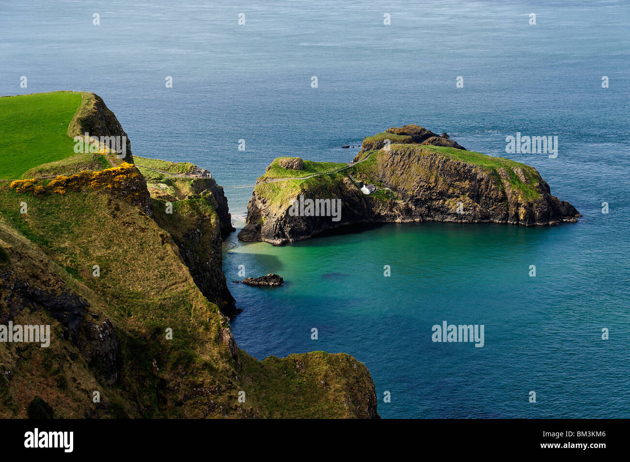 A view of Carrick Island on the North Antrim Coast. - Stock Image