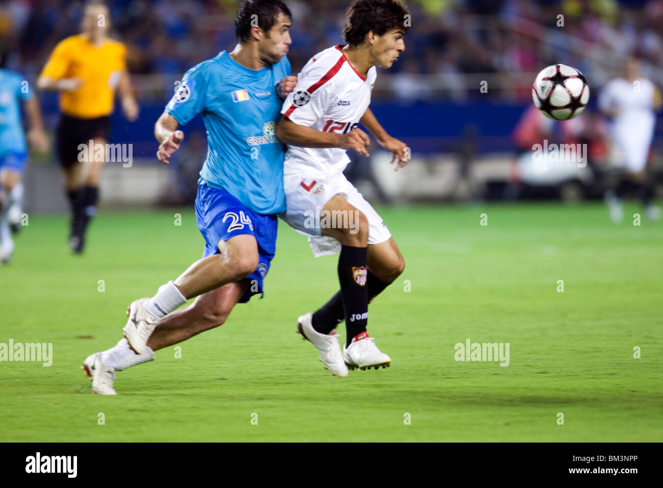 Perotti and Vasile Maftei fighting for the ball. - Stock Image