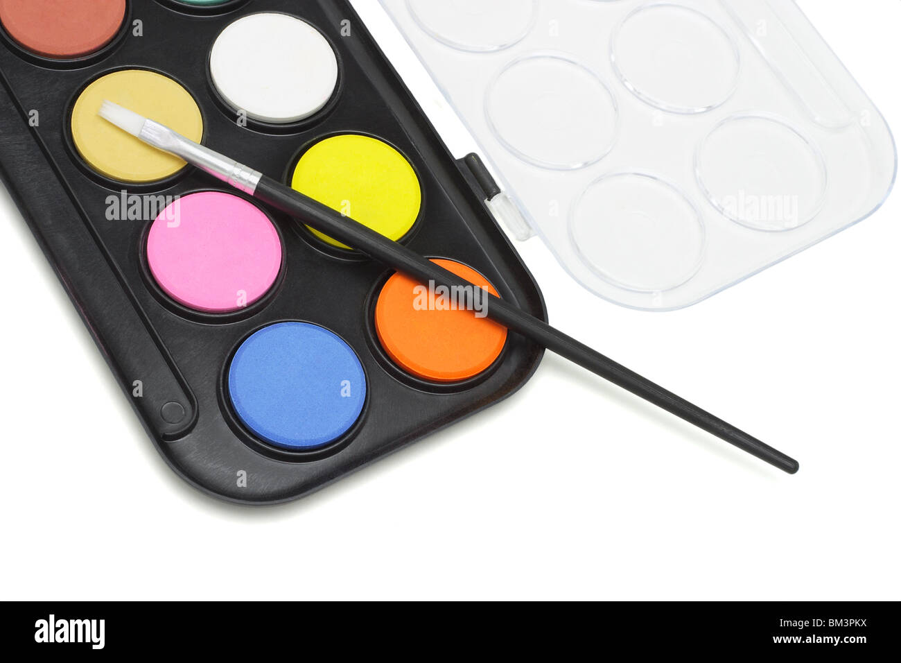 Watercolor paint set with brush on white background - Stock Image