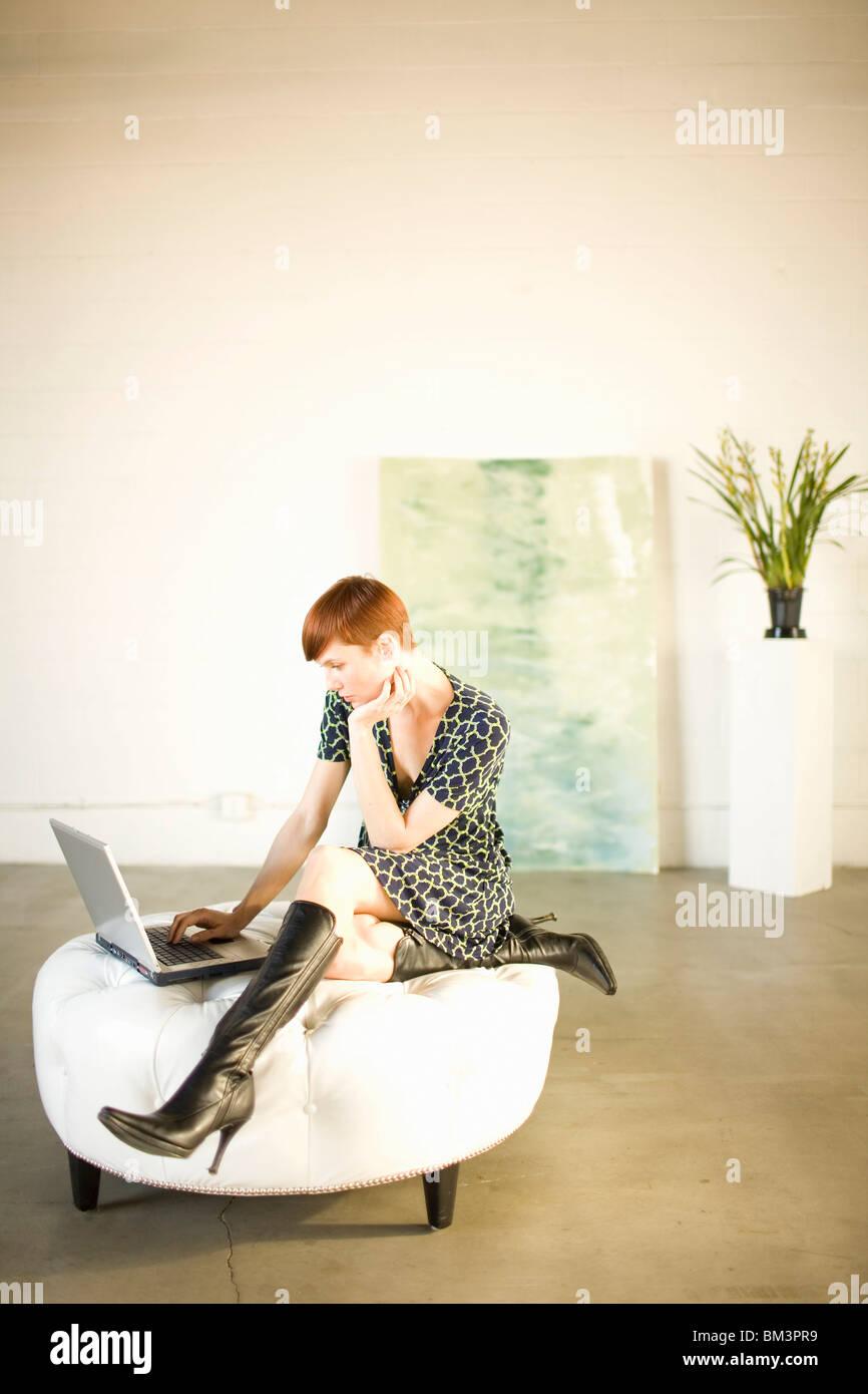 Woman in gallery or loft - Stock Image