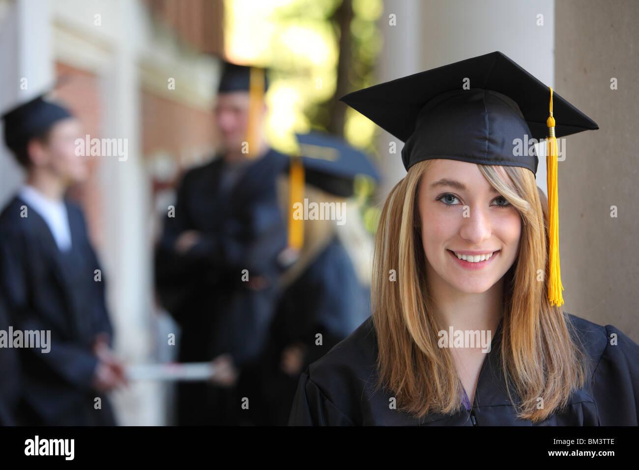Portrait of female graduate - Stock Image