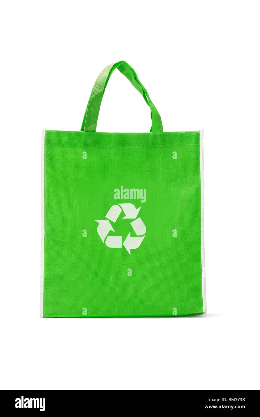 Green reusable shopping bag with recycle symbol on white - Stock Image