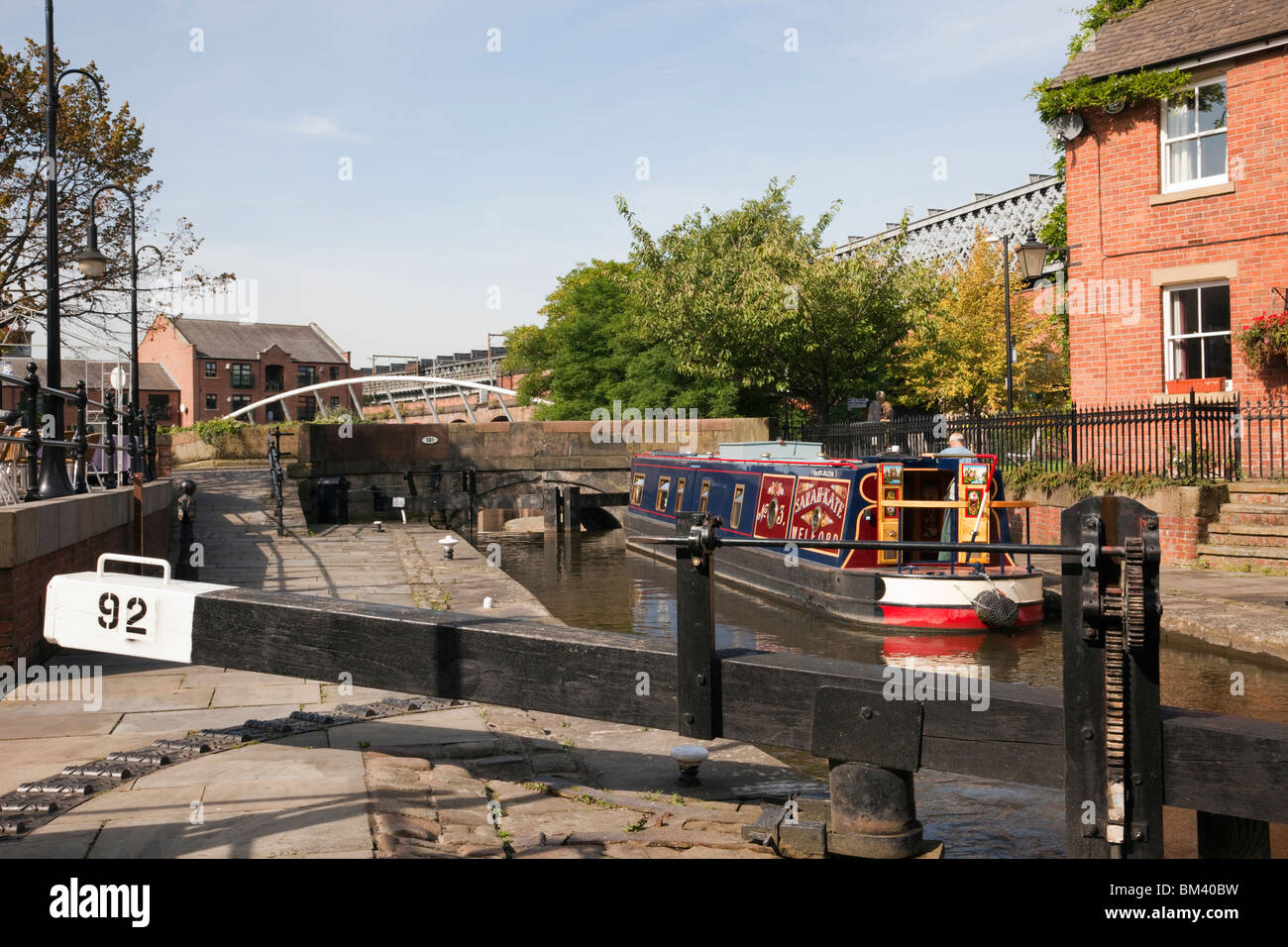 Narrowboat in Dukes Lock 92 on the Rochdale canal in Castlefield Urban Heritage Park. Manchester, England, UK, Britain. - Stock Image