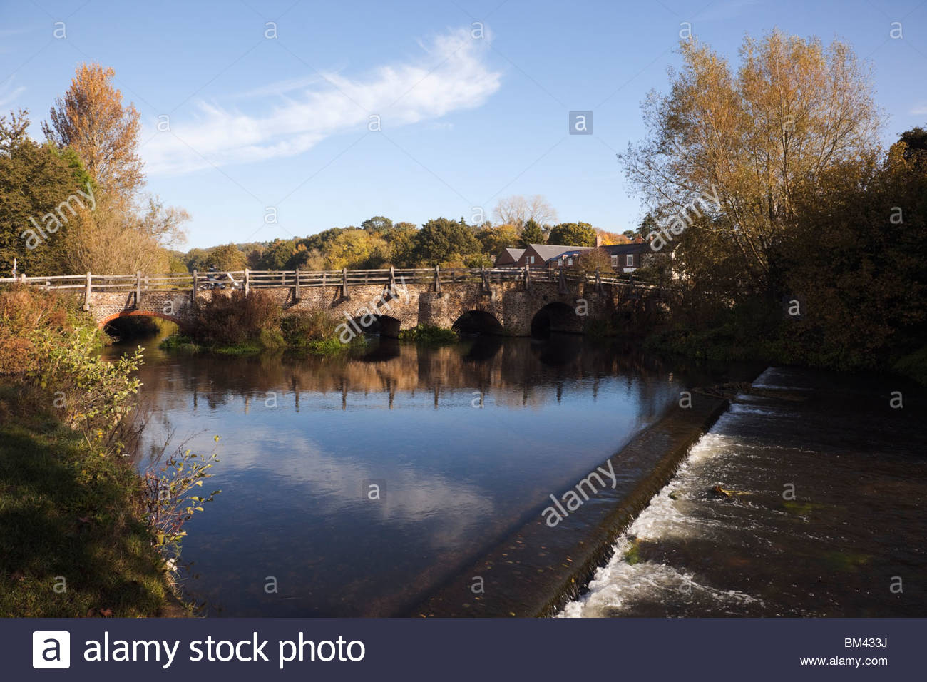 Tilford Surrey England UK Europe. River Wey and old east bridge in autumn - Stock Image