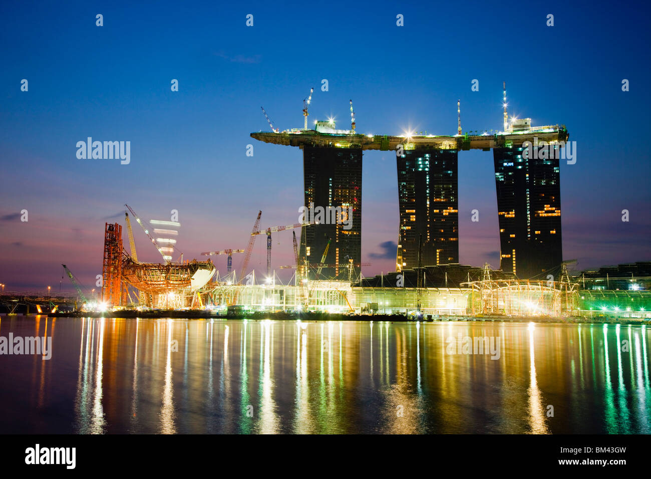 The Marina Bay Sands Hotel and Casino under construction on the Marina Bay waterfront, Singapore - Stock Image