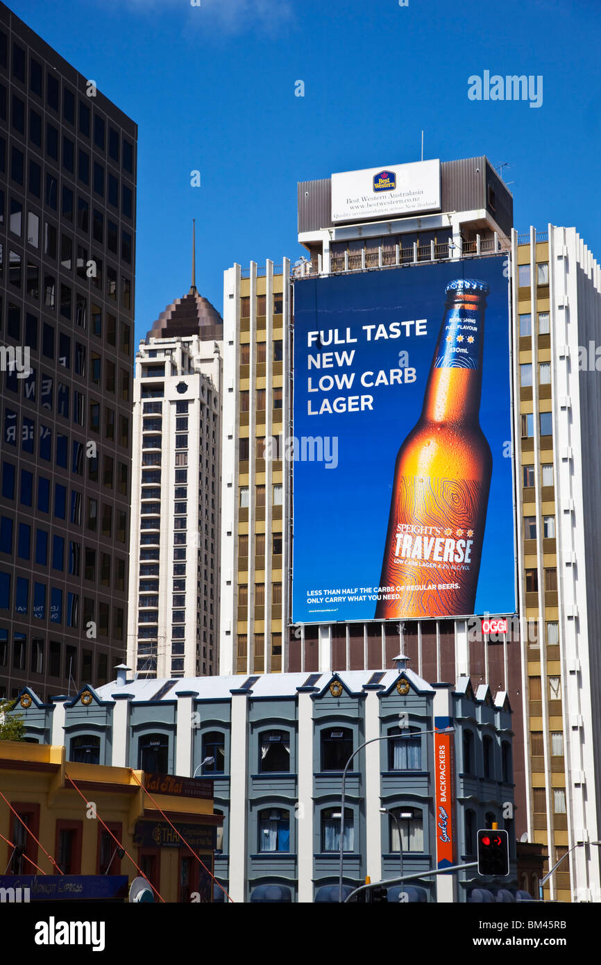 Advertising billboard on city highrise. Auckland, North Island, New Zealand - Stock Image