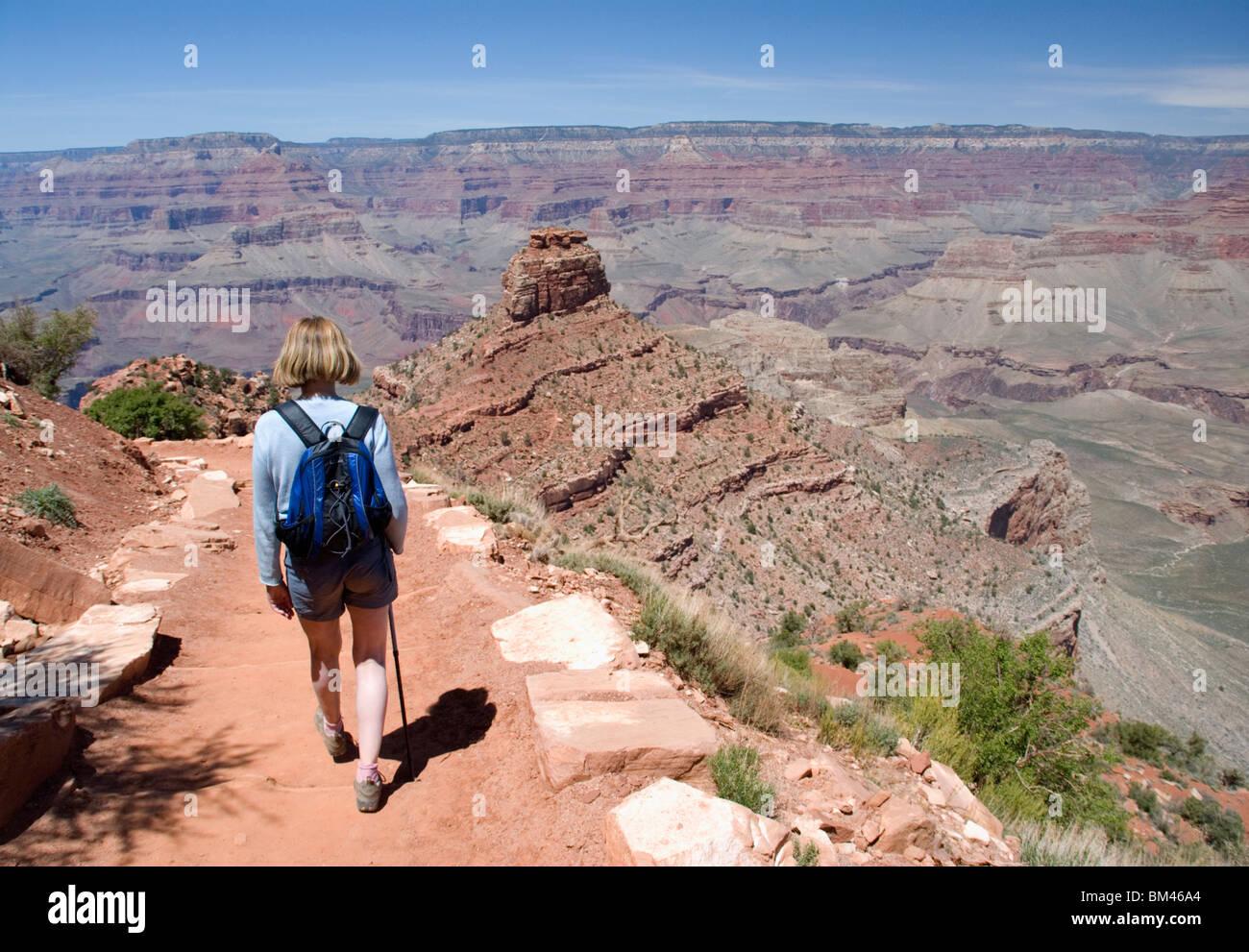 Female hiker hiking descending on the South Kaibab Trail south rim Grand Canyon National Park Arizona USA Kimberly - Stock Image