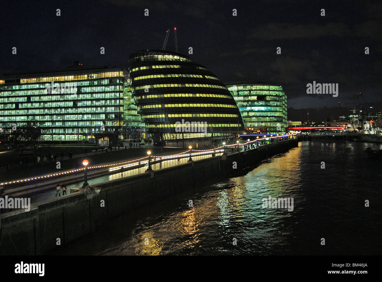 Floodlit buildings along the Thames, London, UK - Stock Image