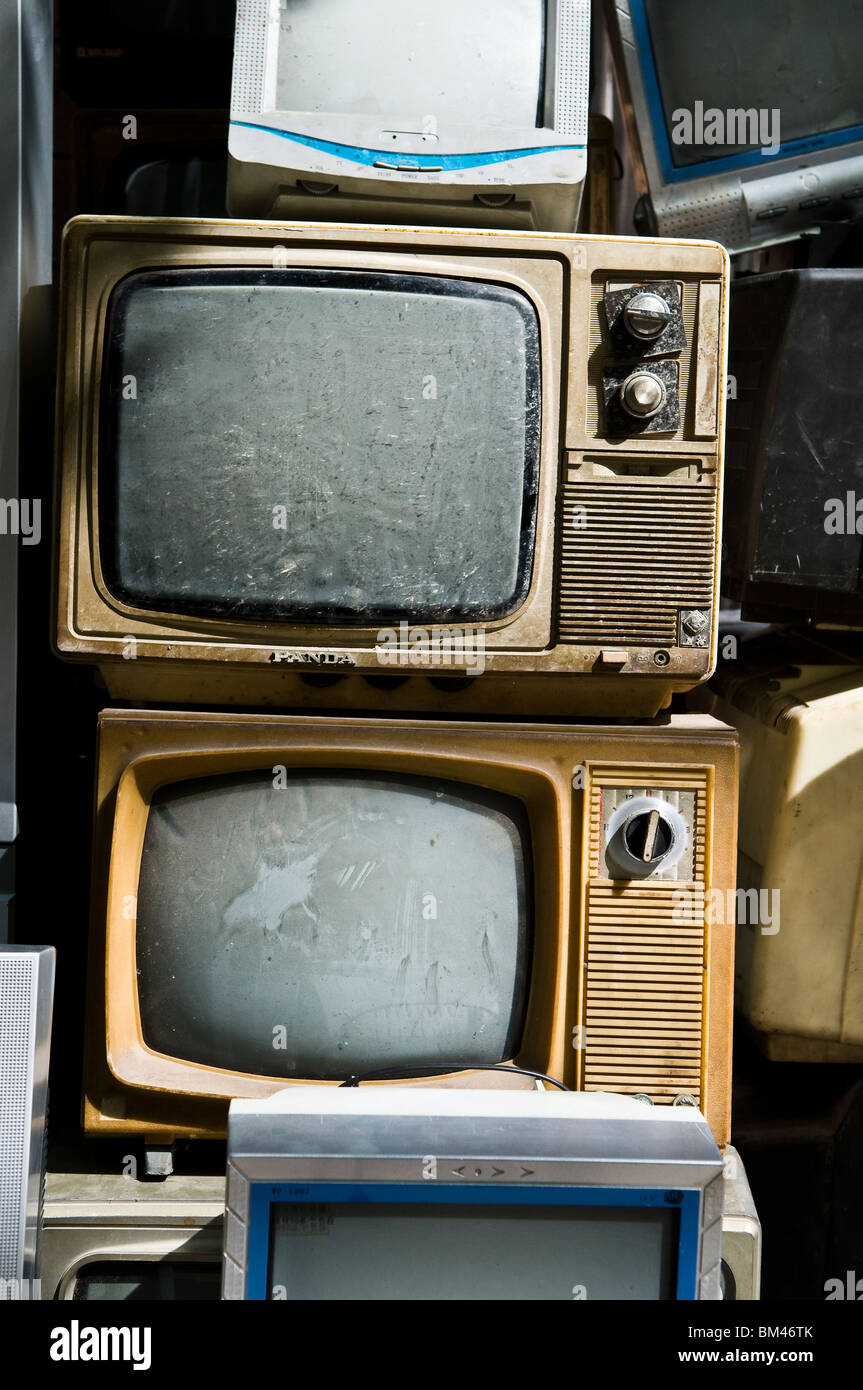 Old televisions sets sold in a 2nd hand electronic shop in China. - Stock Image