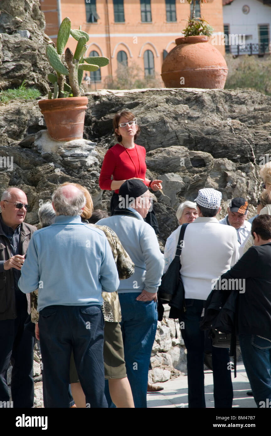 tour guide guides guided holiday makers visitors tourist tourists tourism tours history informative italy italian - Stock Image