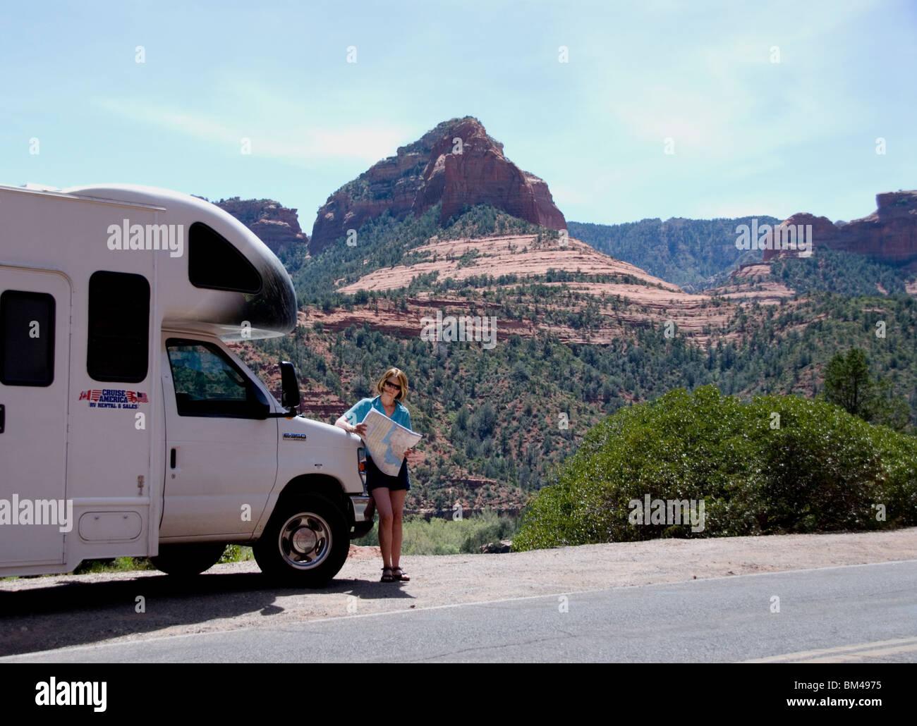 Woman reading map rented RV recreational vehicle Cruise America in Oak Creek Canyon Sedona Arizona USA Kimberly - Stock Image