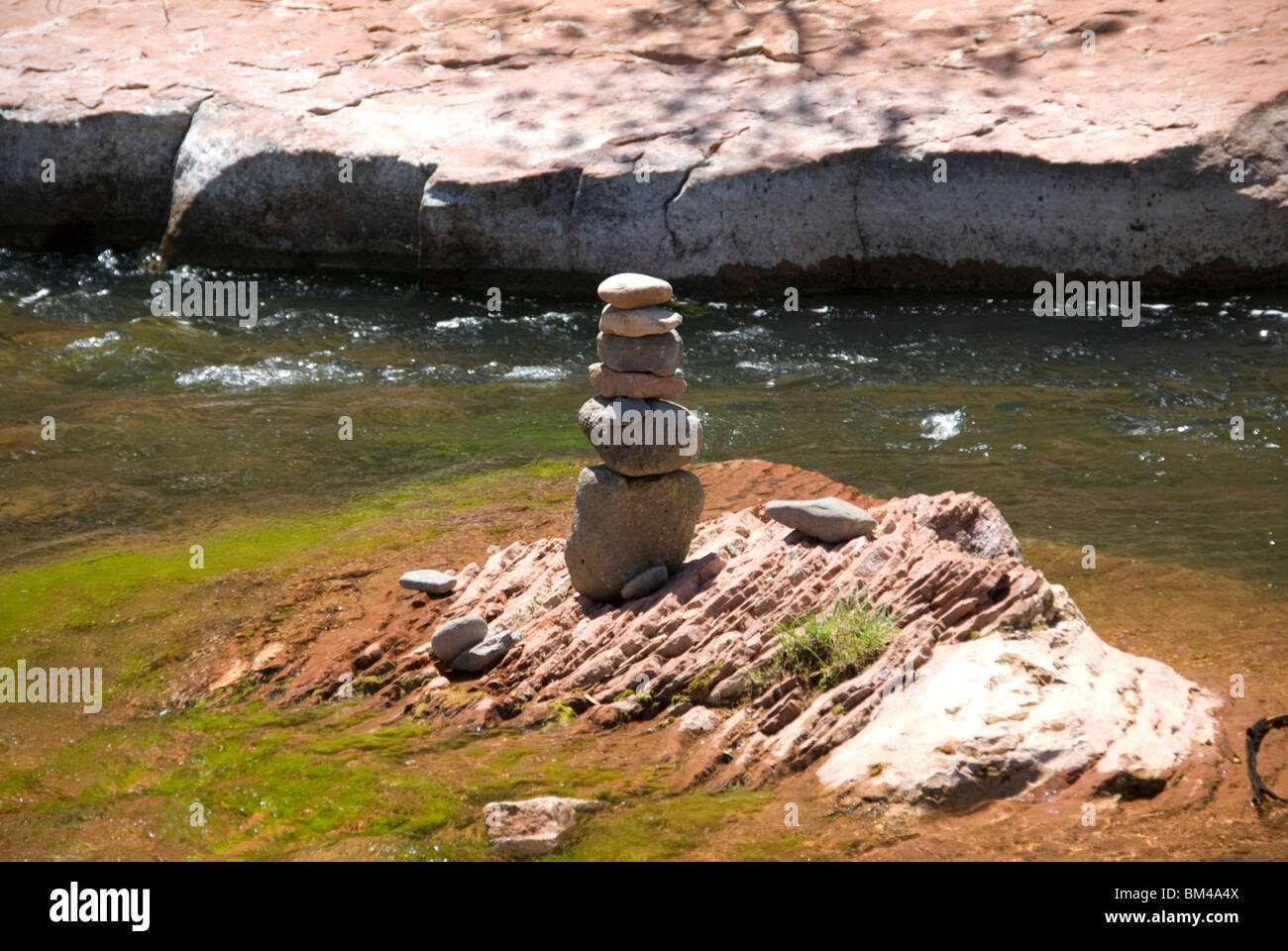 Pebbles arranged as standing stone sculptures at Oak Creek River in Red Rock State Park just outside Sedona Arizona Stock Photo