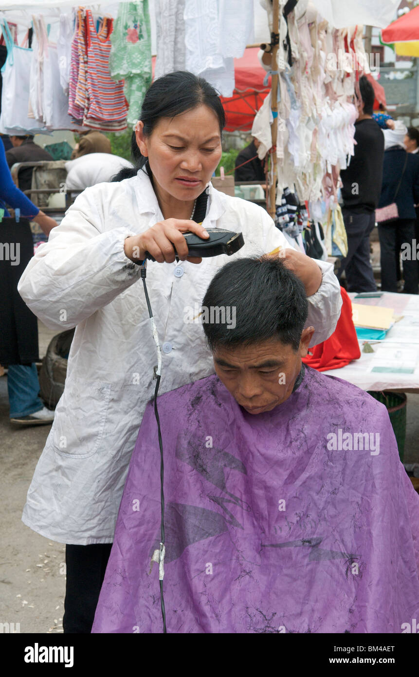 Barber Cutting Hair China High Resolution Stock Photography and