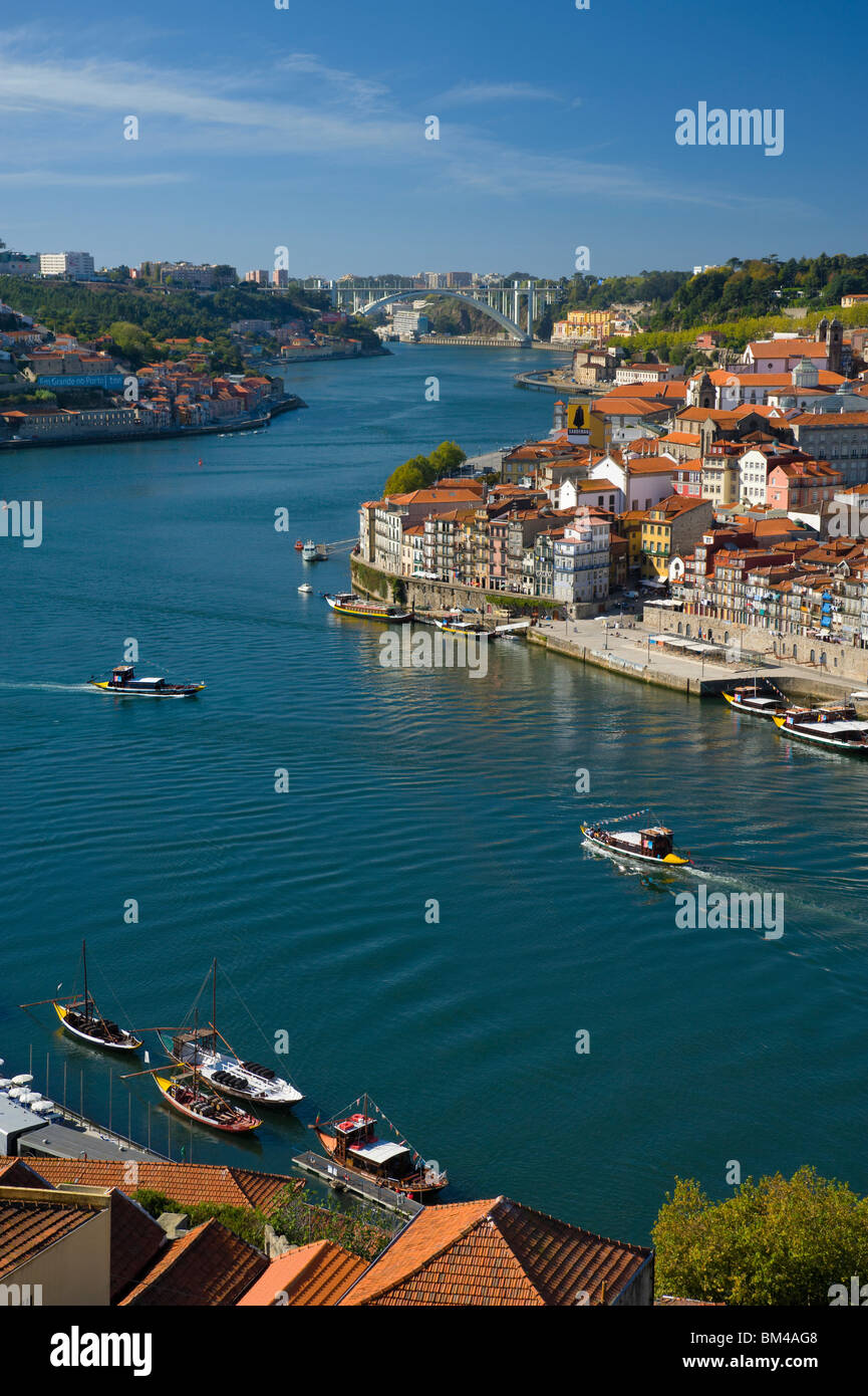 Portugal, The Costa Verde, Porto, Oporto, The Ribeira District On The Douro, With Port Wine Barges, now excursion - Stock Image