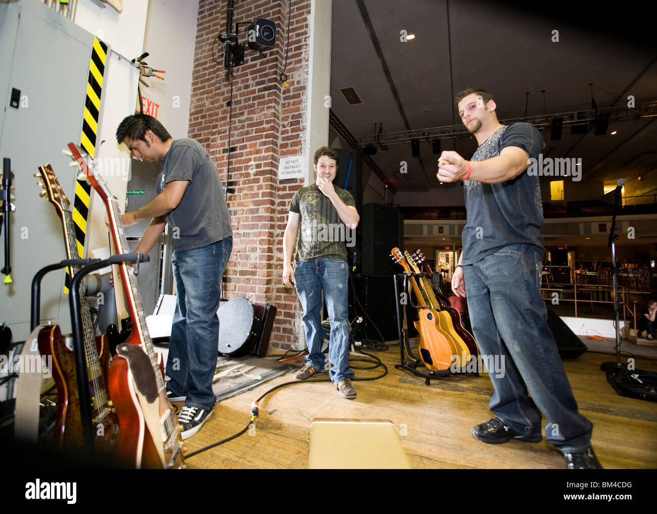 Rock band preparing for performance - Stock Image