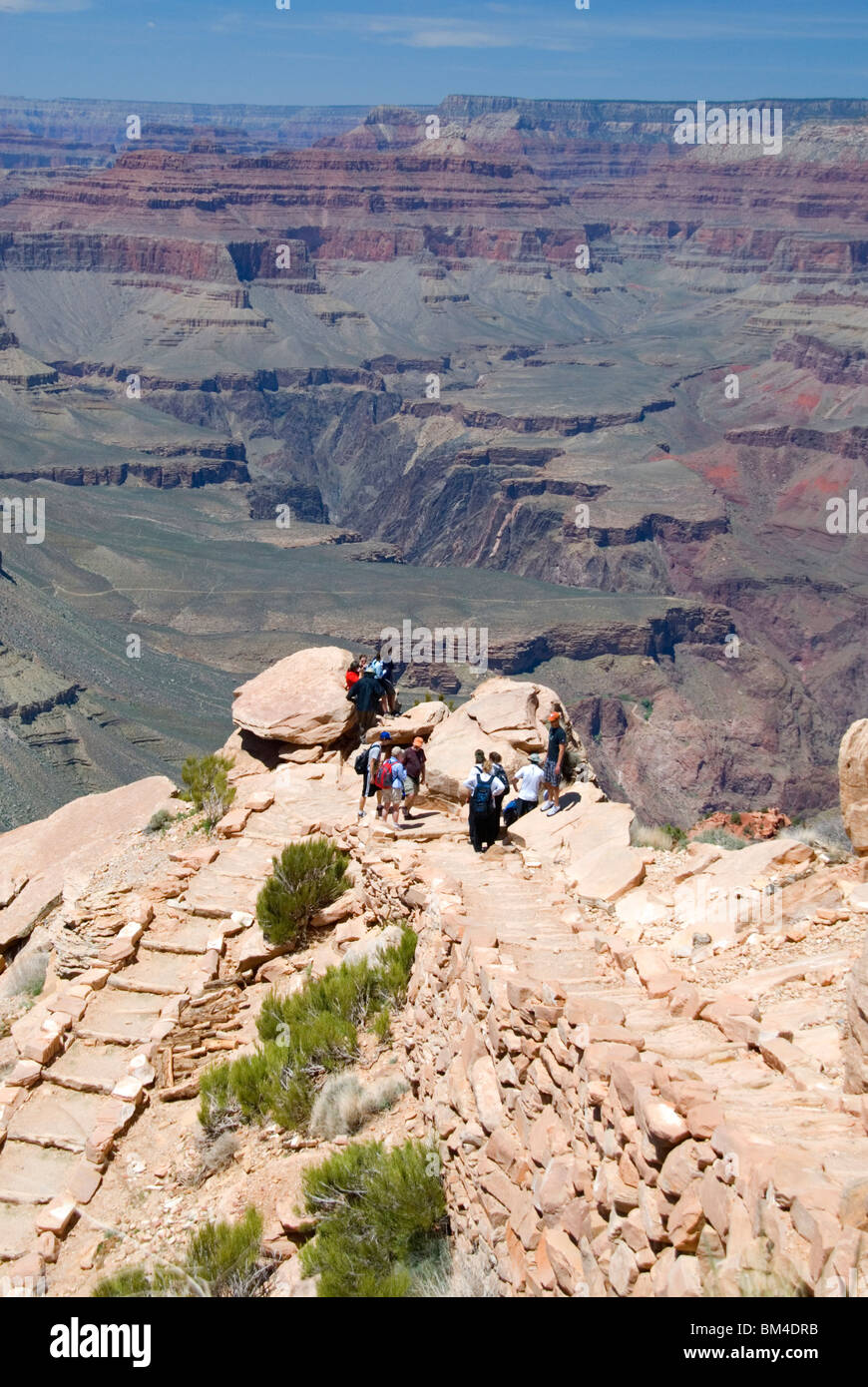 Hikers at Ooh-Aah Point on the South Kaibab Trail south rim Grand Canyon National Park Arizona USA  - Stock Image