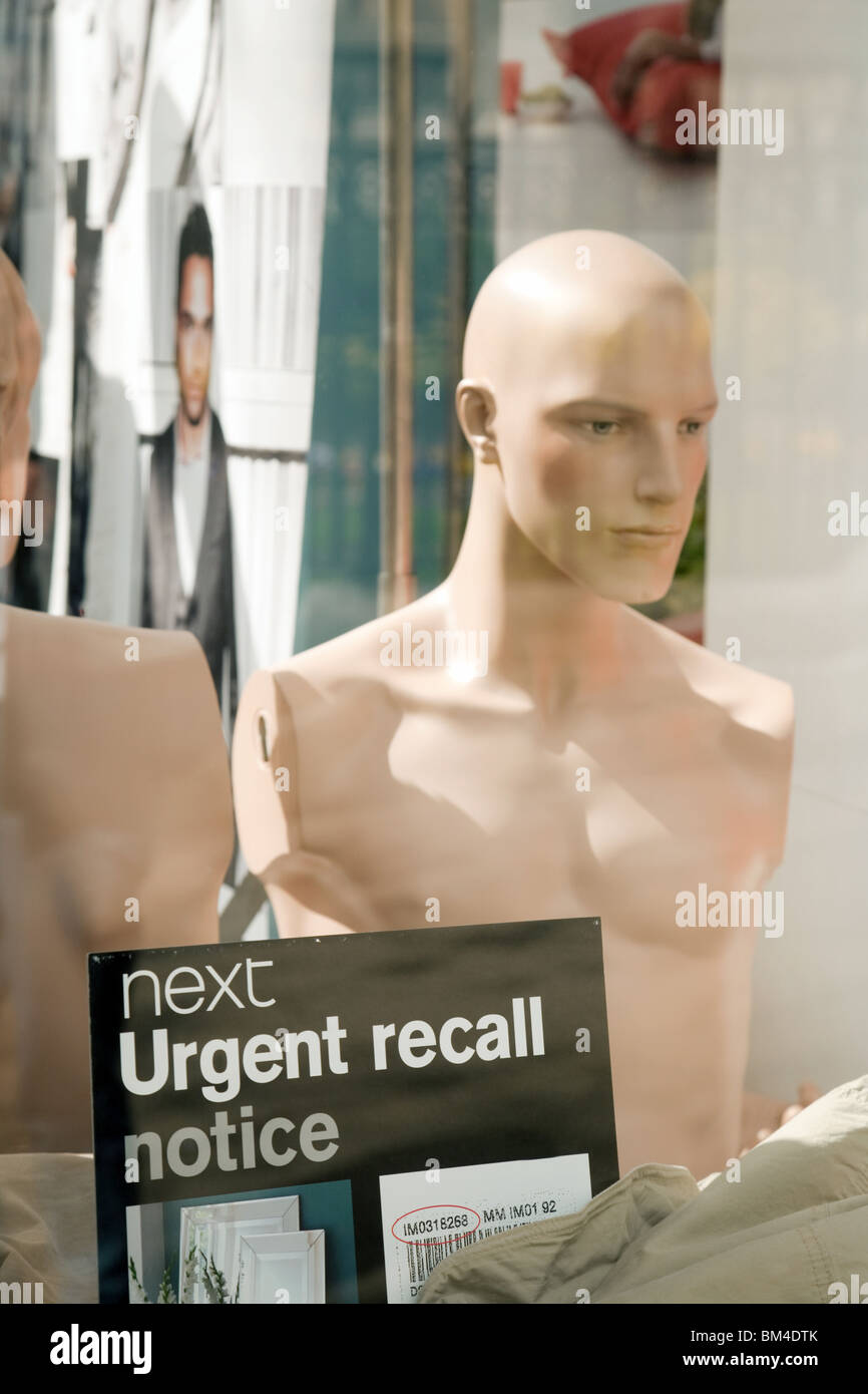 Undressed dummy in the window of a Next store, Norwich, UK - Stock Image