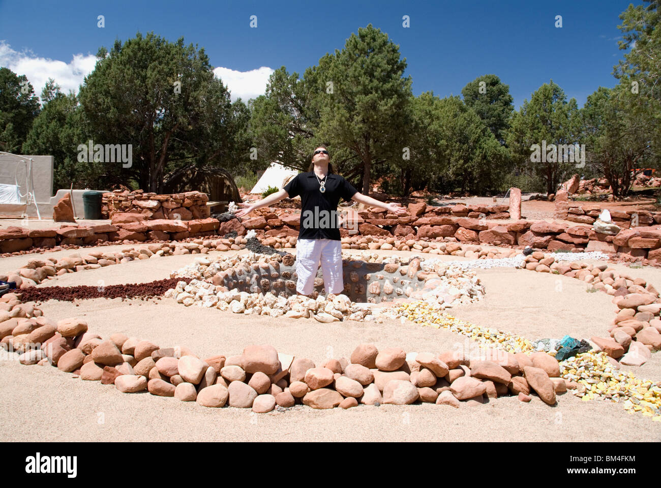 Medicine wheel shamanic circle healing earth energy vortex sacred site with psychic Brian Sedona Arizona USA - Stock Image