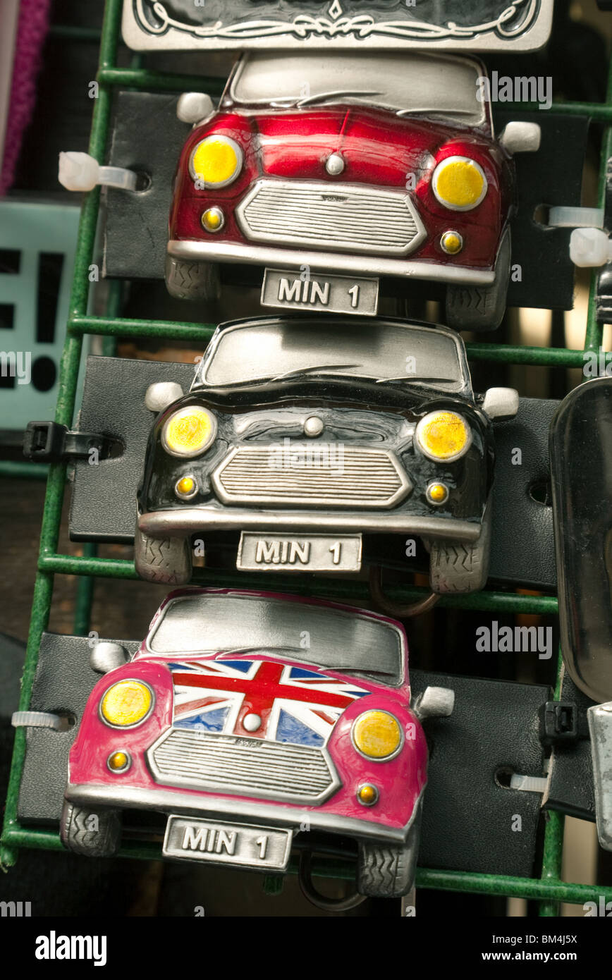 Three mini car  fridge magnets on sale in a market stall, Norwich, UK - Stock Image