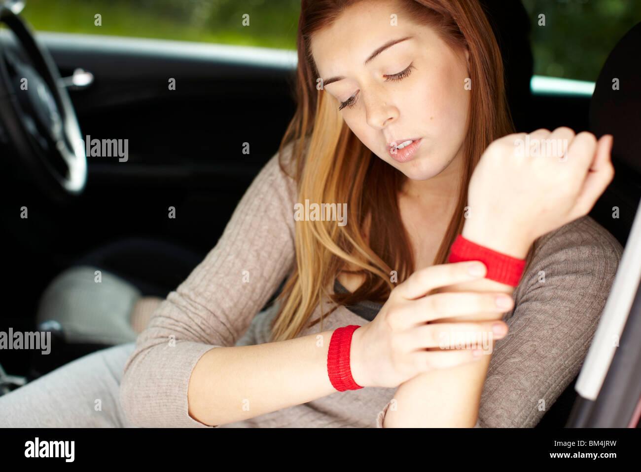 Girl wearing Seabands - Stock Image