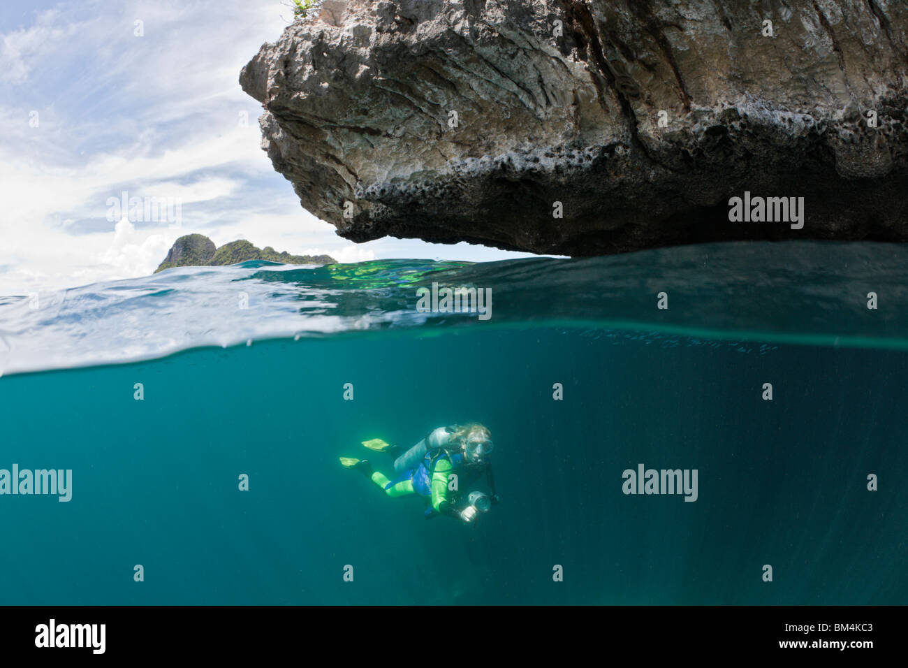 Scuba Diver in Shallow, Raja Ampat, West Papua, Indonesia Stock Photo