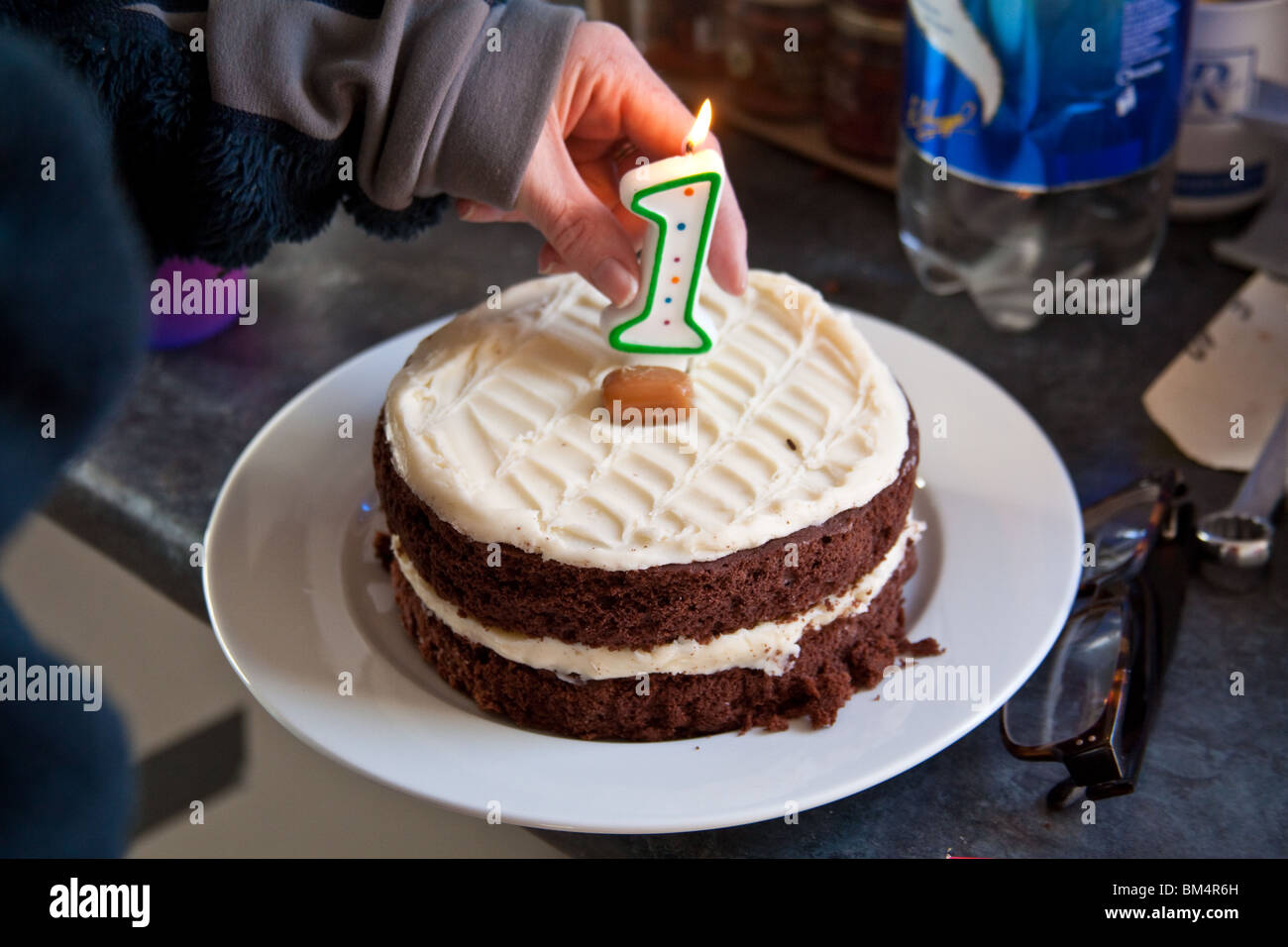 Chocolate, birthday cake with a number 1 candle. - Stock Image