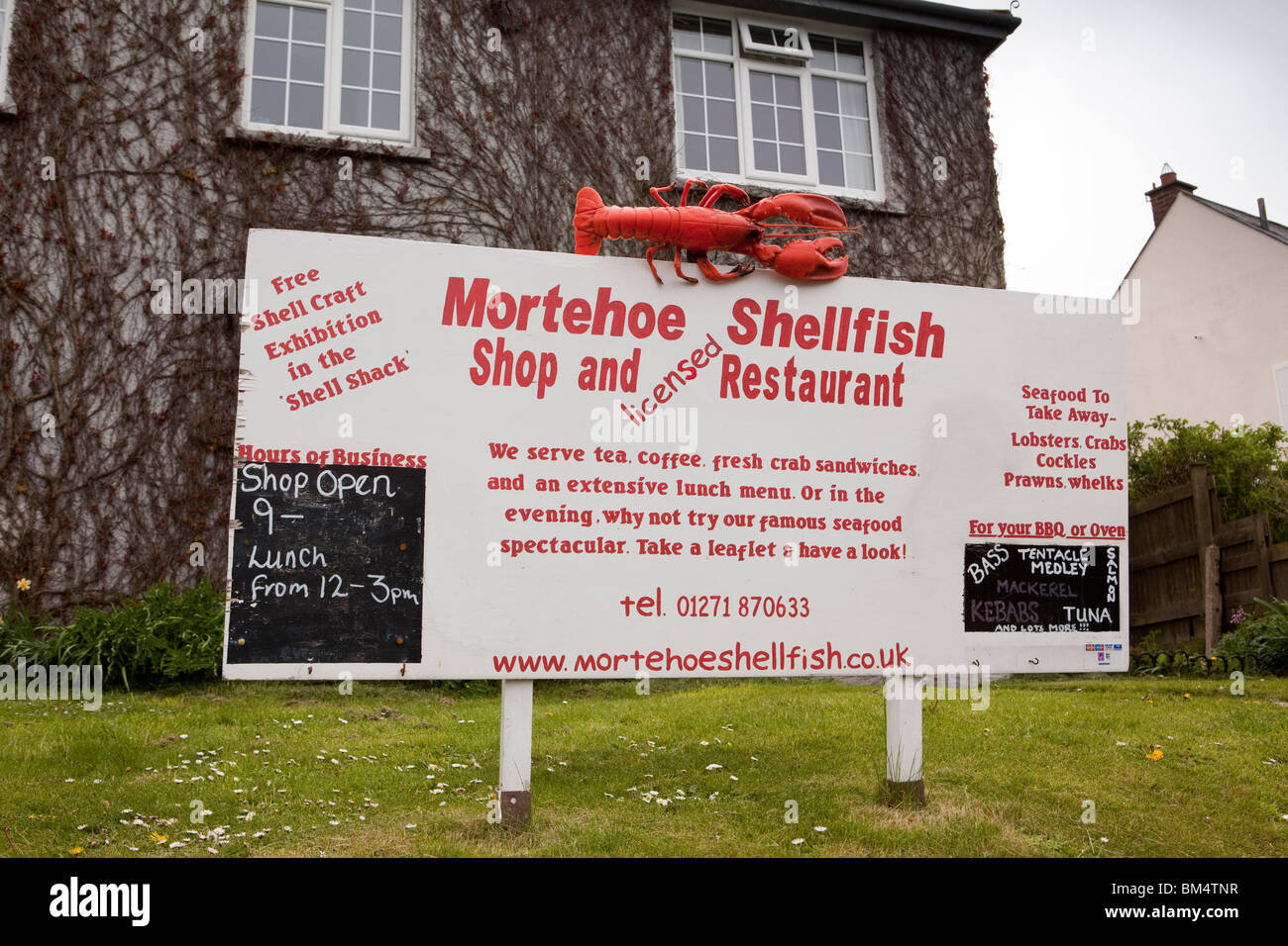 UK, England, Devon, Woolacombe, Mortehoe, shellfish shop and restaurant in former council house - Stock Image