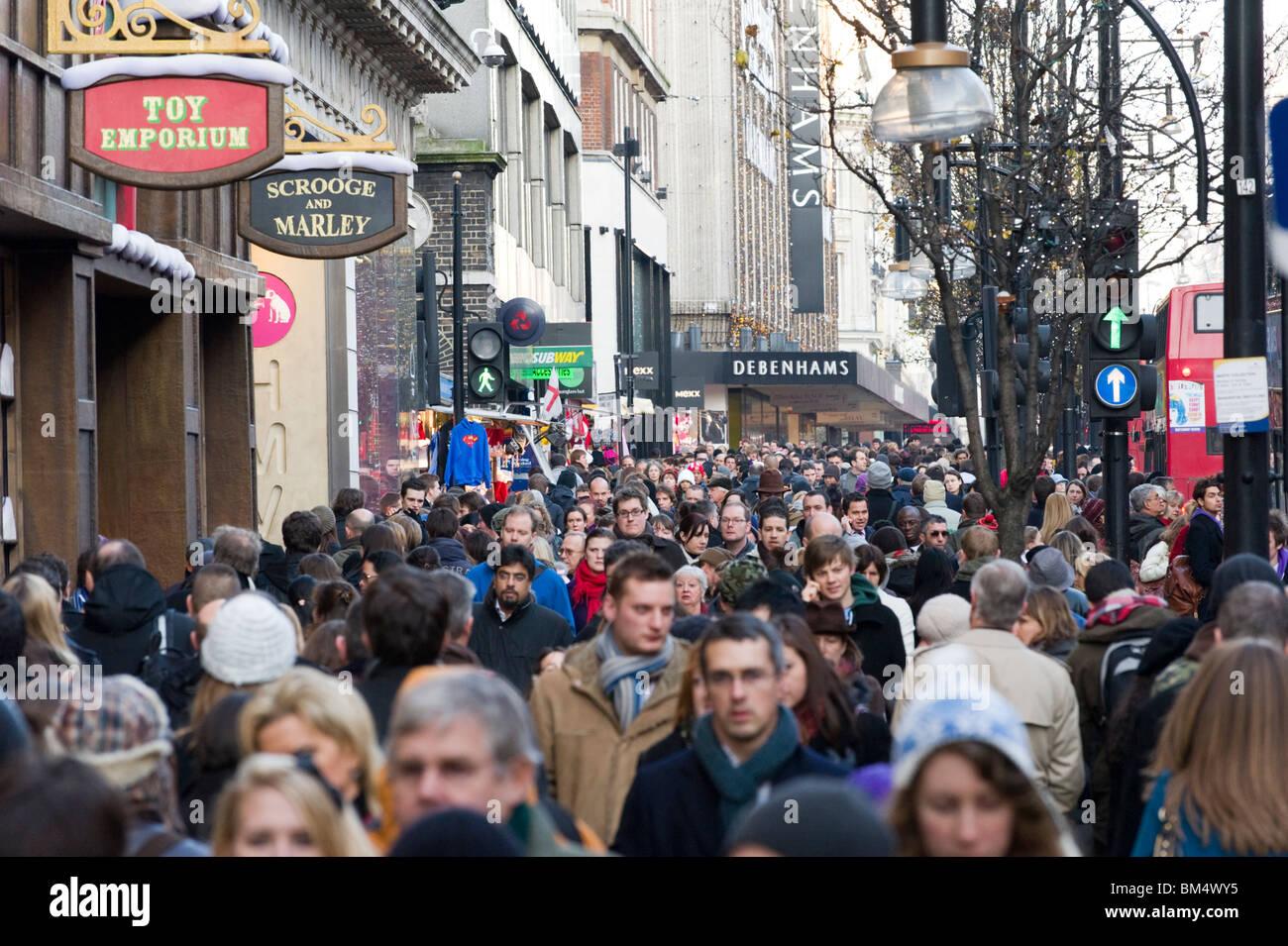 Christmas shoppers on Oxford Street, London, England, UK - Stock Image