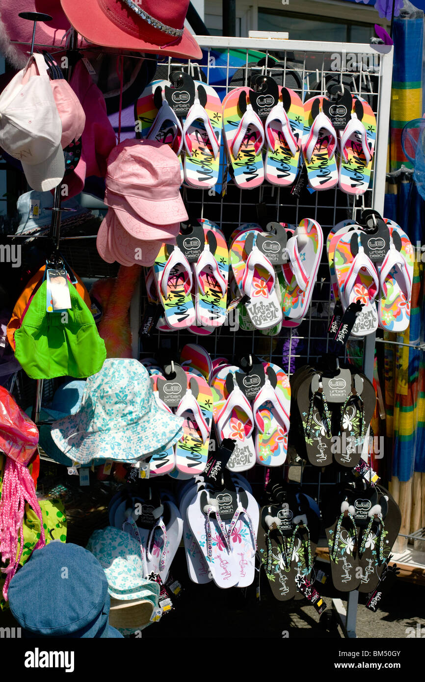 f4f6e1ce587e Beach Shop on Sea front selling flip flops and caps in Weymouth - Stock  Image