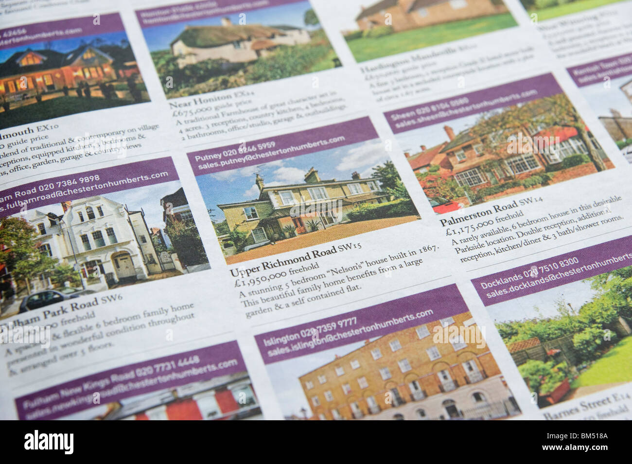 Houses for sale ads in newspaper, London, England, UK - Stock Image