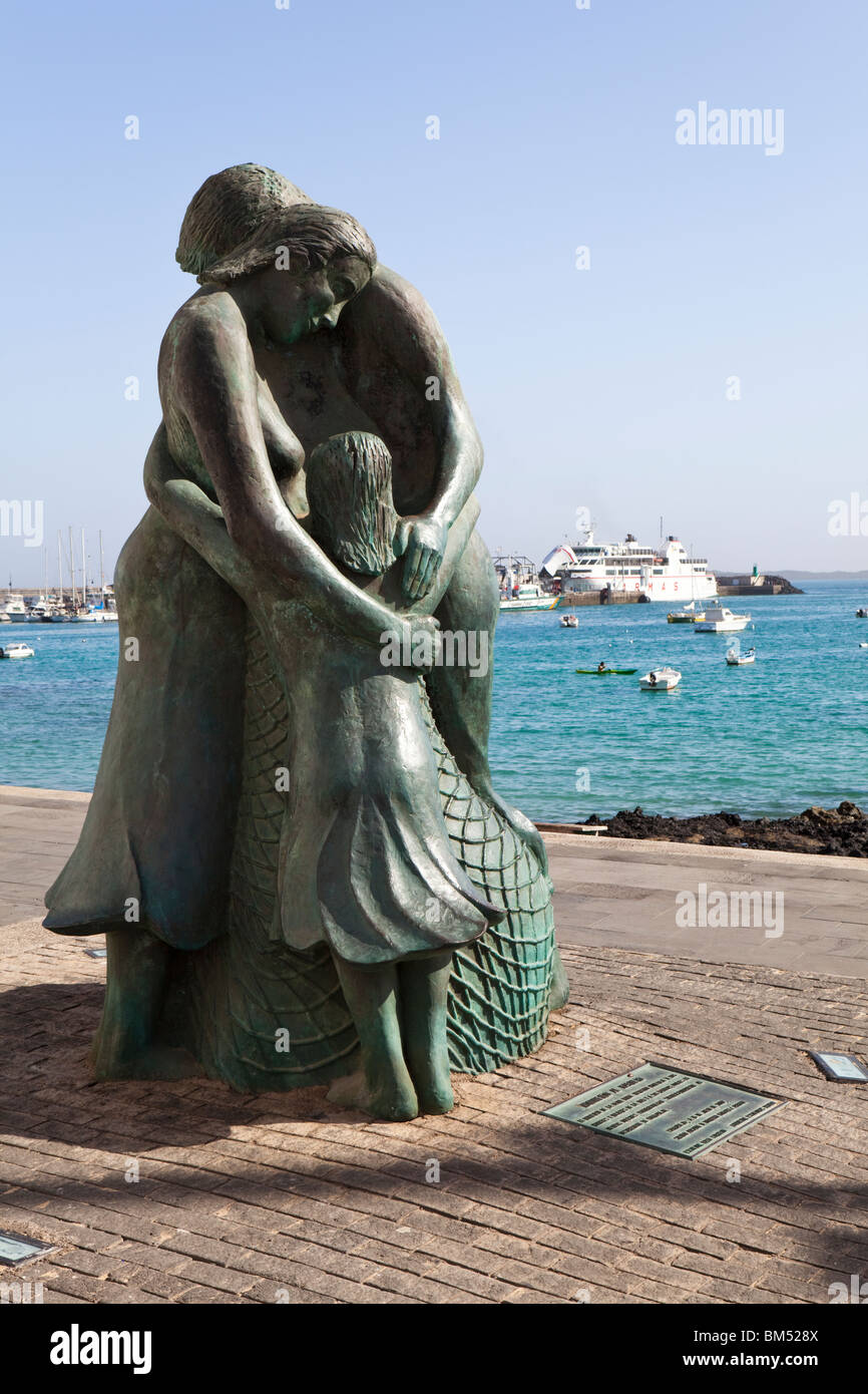 The sailors monument on the harbourfront at the coastal resort of Corralejo on the Canary island of Fuerteventura. - Stock Image