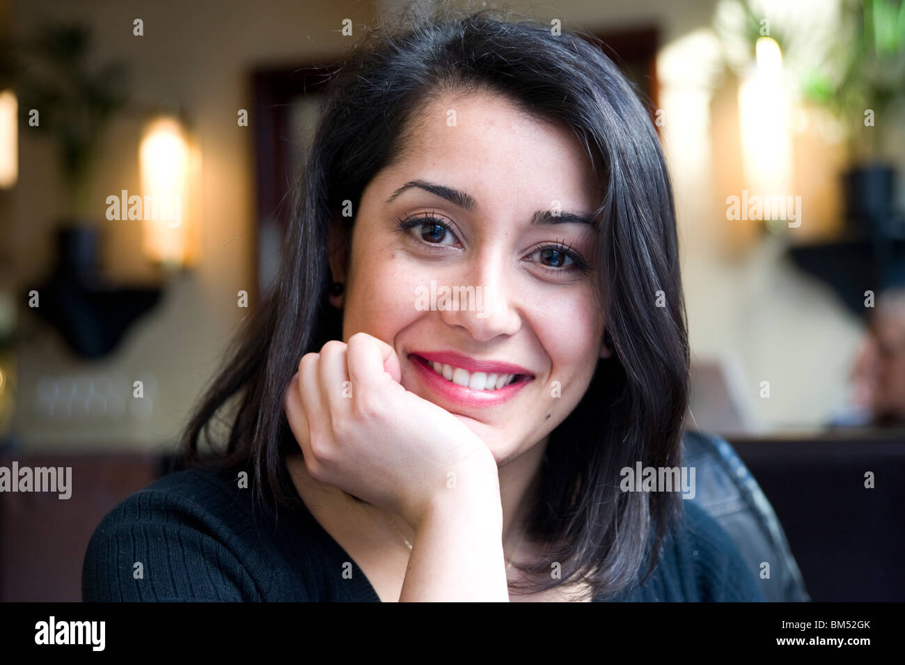 Portrait of young Turkish woman, England, UK - Stock Image
