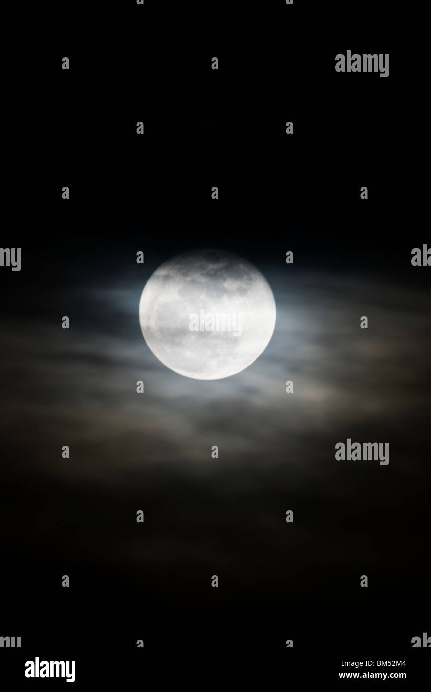 Full moon rises over the small mountain town of Salida, Colorado, USA - Stock Image