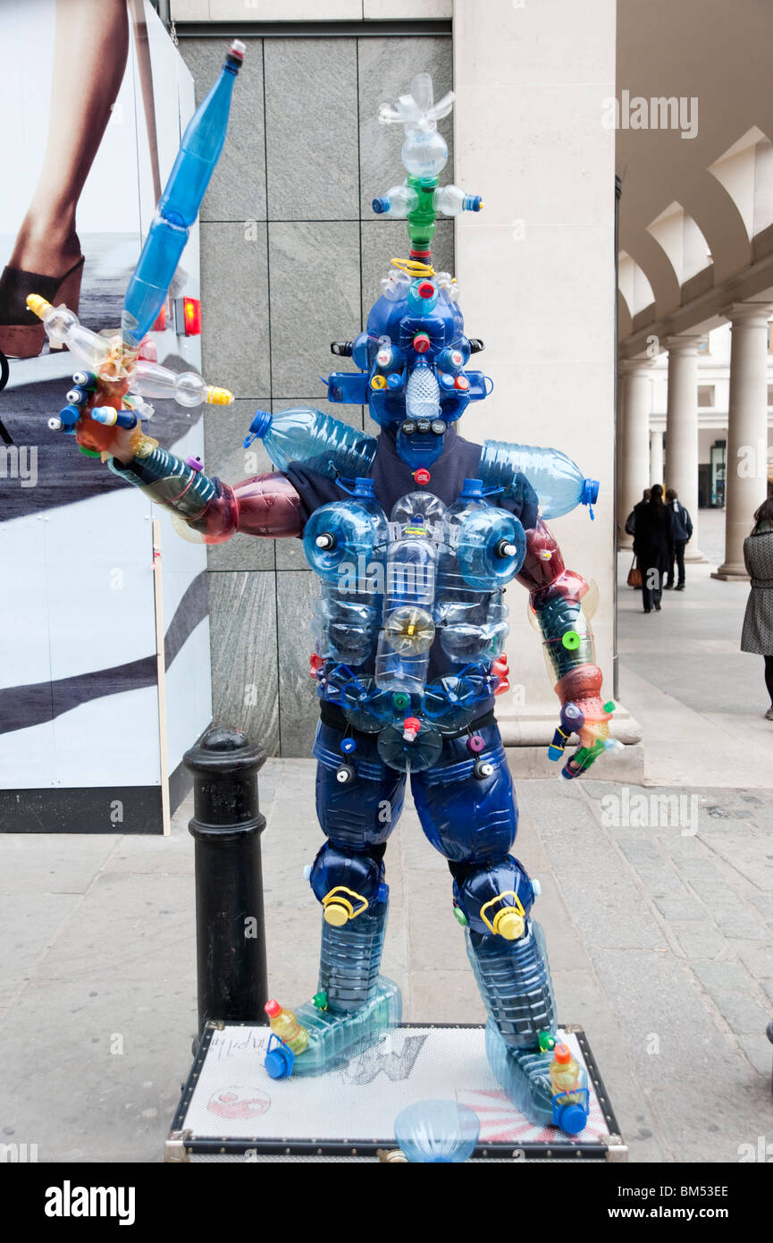 Human statue using recycled plastic bottles in Covent Garden, London, England, Britain, UK - Stock Image