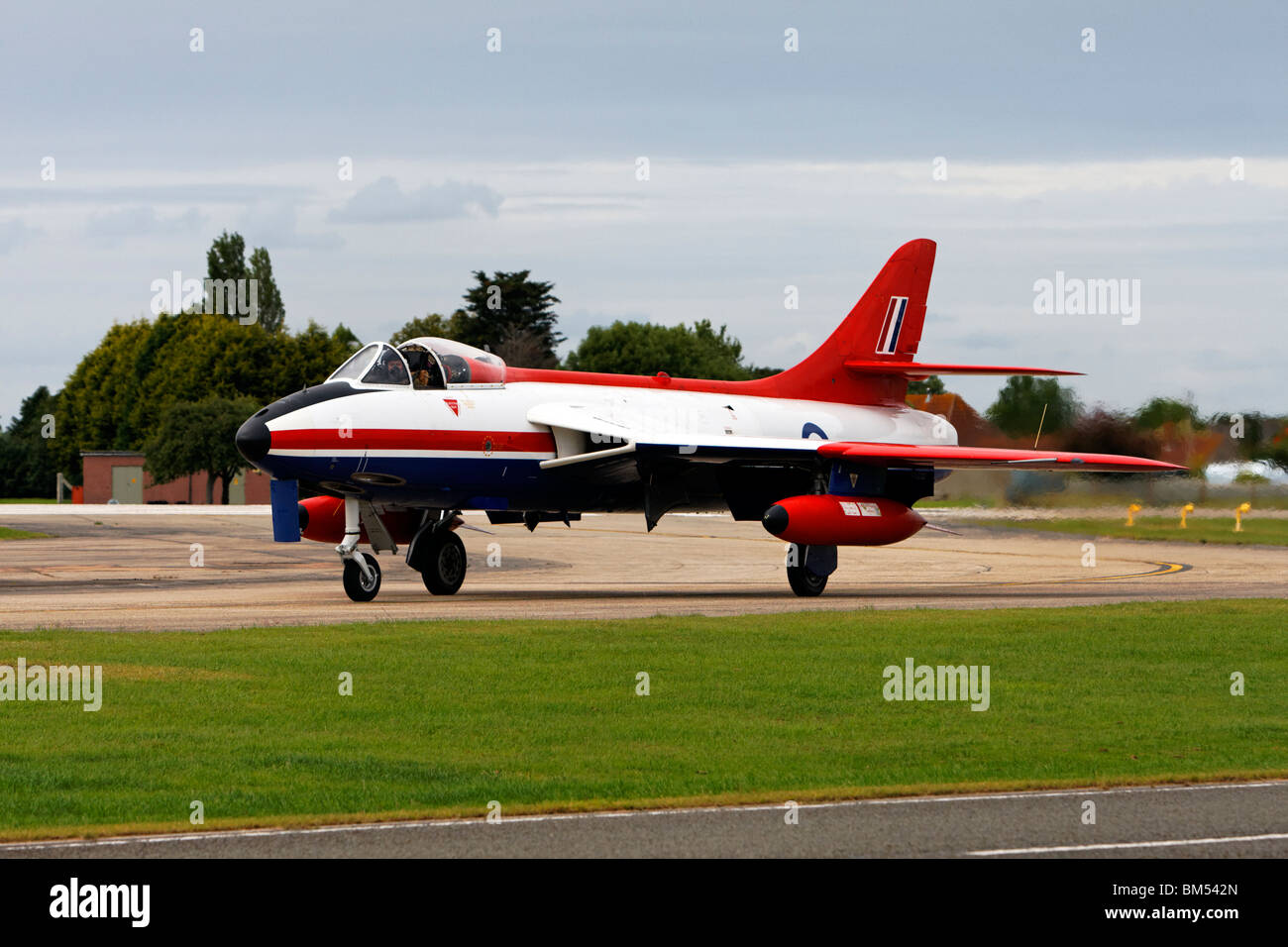 Skyblue Aviation's ex-ETPS red, white and blue Hawker Hunter FGA.9 XE601/G-ETPS taxying. - Stock Image