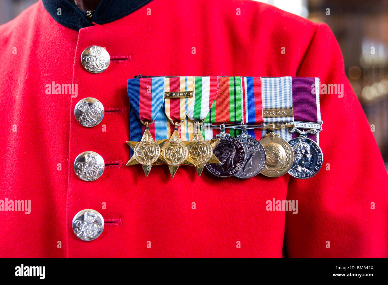 War medals on the scarlet coat of In-Pensioner John Ley at the Royal Hospital Chelsea in London, England UK - Stock Image