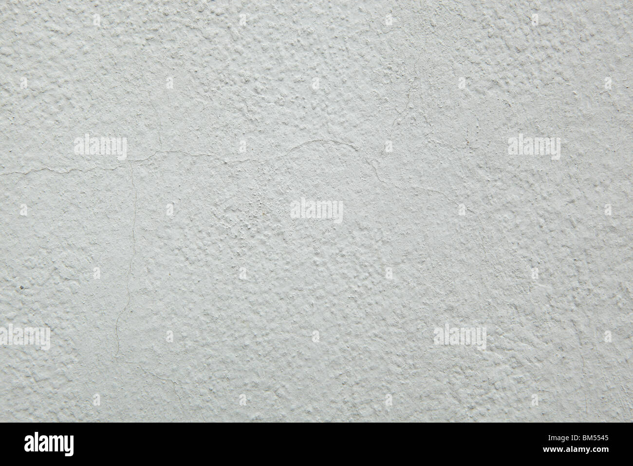 Light grey painted wall background with visible paint texture Stock