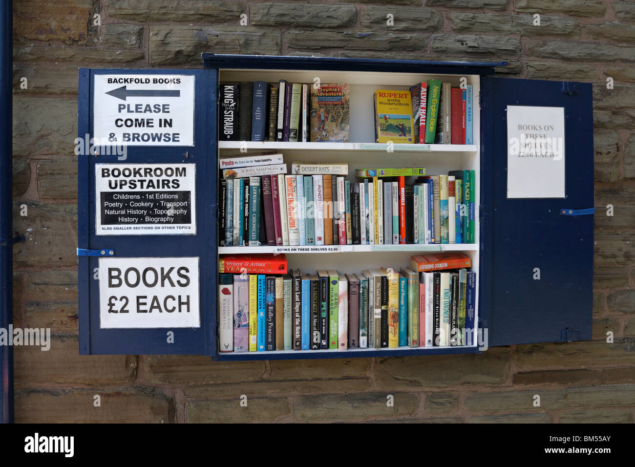 Selection of books for sale outside Backfold's bookshop in Hay on Wye in Powys Mid Wales - Stock Image