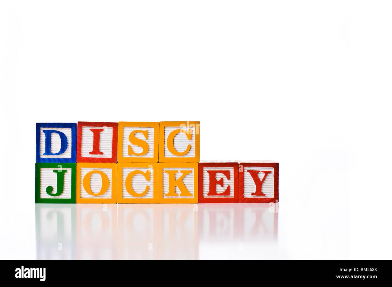 Colorful children's blocks spelling DISC JOCKEY - Stock Image