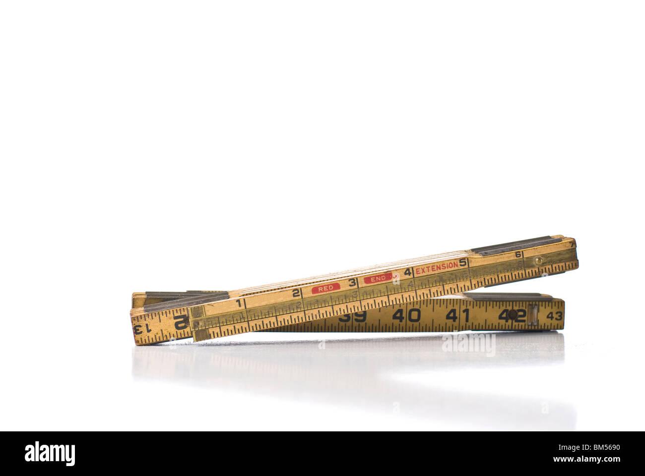 Folding carpenter's ruler - Stock Image