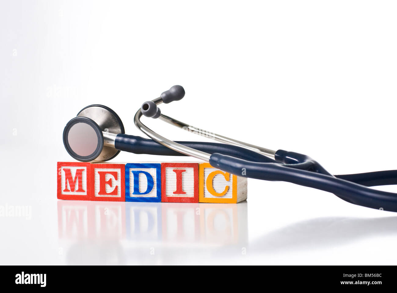 Colorful children's blocks that spell MEDIC with a stethoscope - Stock Image