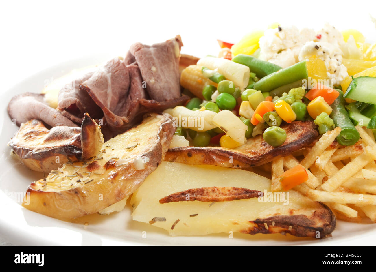 Roast beef with salad, potatoes and bernaise sauce isolated on white. - Stock Image