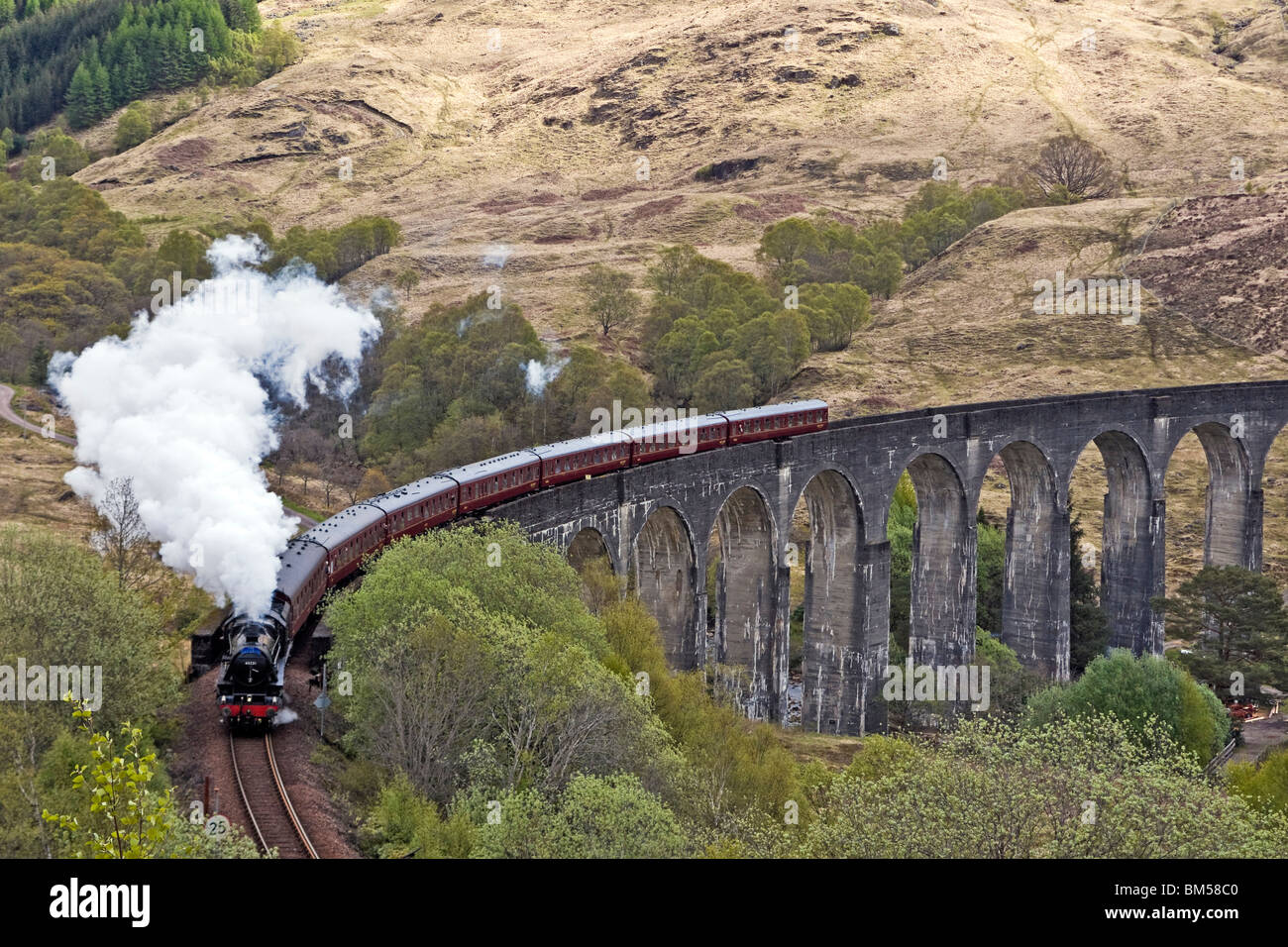 Black Five steam engine No. 45231 pulls the first Jacobite of the season over the famous Glenfinnan Viaduct en route - Stock Image