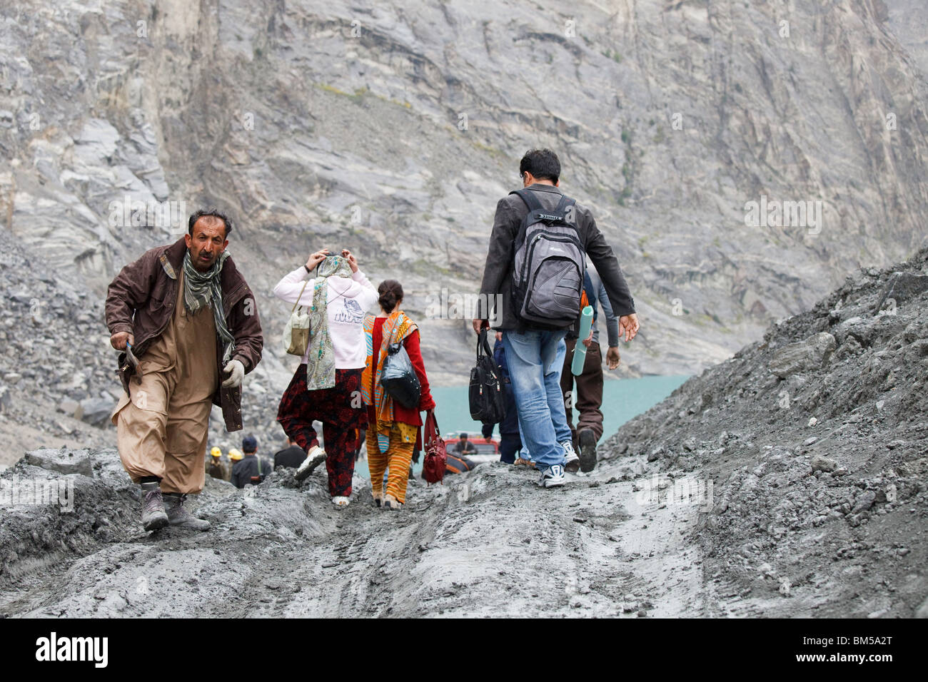 Workers at the landslide area at Attabad which blocks the Karakoram Highway, Hunza, Pakistan - Stock Image