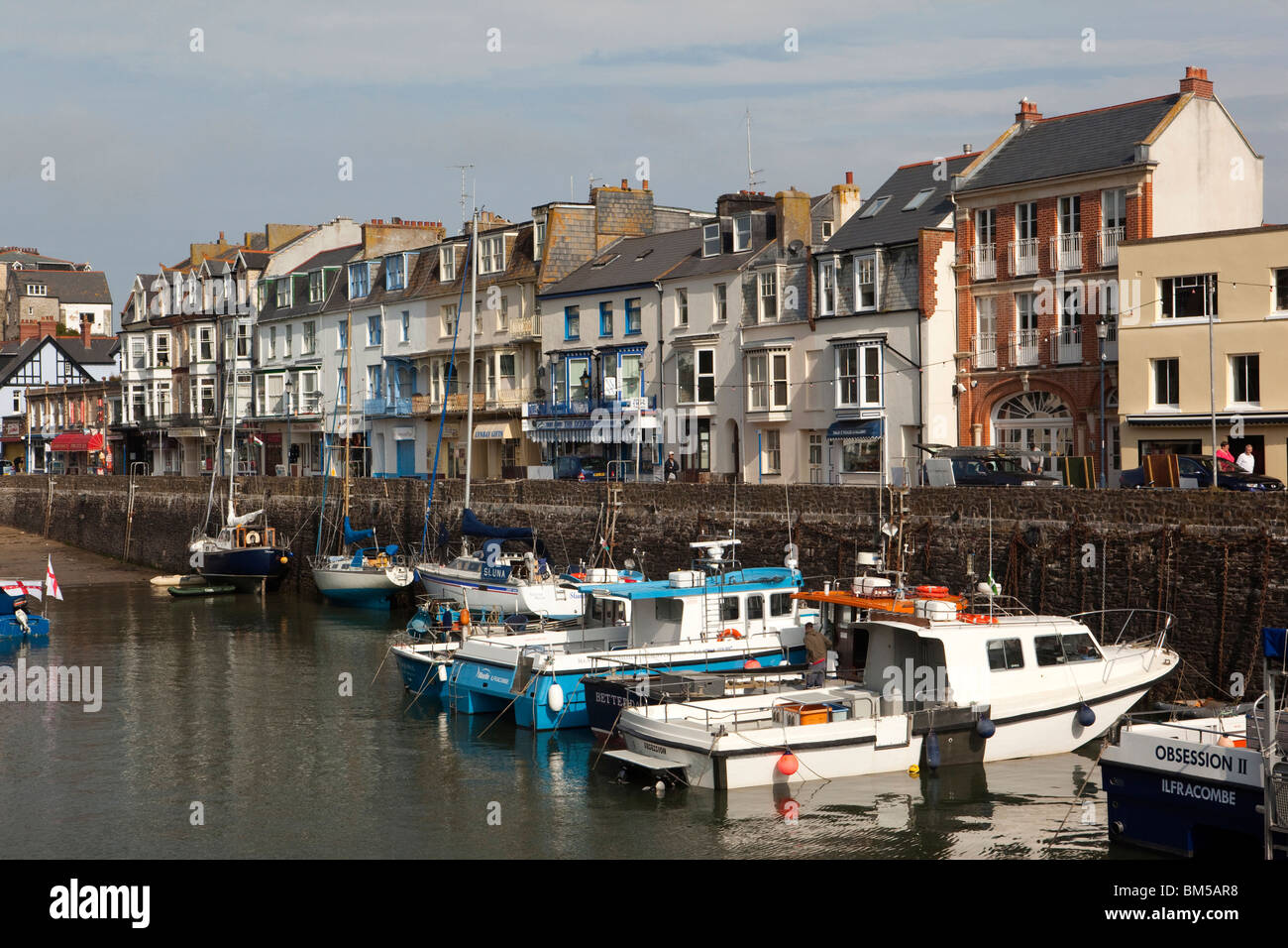 UK, England, Devon, Ilfracombe, harbour, tall houses along the Quay - Stock Image