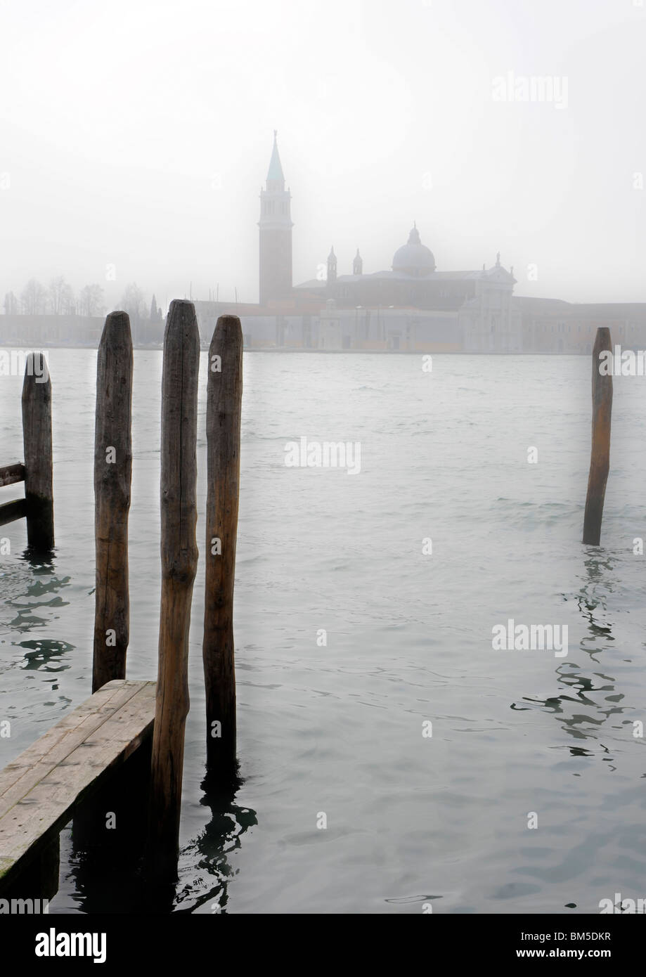 Moorings in Venice, misty day. - Stock Image